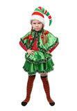 Ilsken liten flicka - jultomten älva på vit Arkivbild