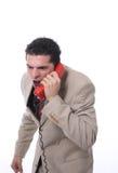 Ilsken man på telefonen Arkivfoto
