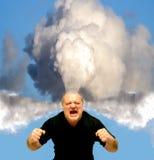 Ilsken man som blåser ånga Arkivbild
