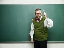 Ilsken manlig nerd och hota Arkivfoton