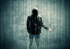Ilsken mystisk en hacker med nummer Fotografering för Bildbyråer