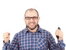 Ilsken skallig man i exponeringsglas Fotografering för Bildbyråer