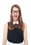 Ilsket isolerat ungt skrika för tonårs- flicka Royaltyfri Bild