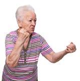 Ilskna danandenävar för gammal kvinna Arkivbilder