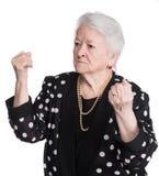 Ilskna danandenävar för gammal kvinna Fotografering för Bildbyråer