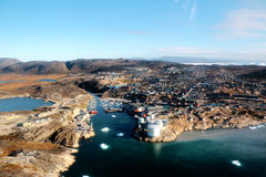 Ilulissat city from a aerial view in Greenland, with fjord of jakobshavn and iceberg Royalty Free Stock Images