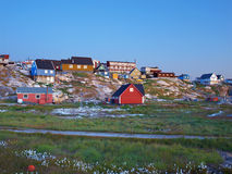 Ilulissat at dusk in summer, Greenland. View from the shore Royalty Free Stock Photos