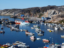 Ilulissat harbour, Greenland. Ilulissat harbour blocked by floating ice brought by the tide Stock Photos