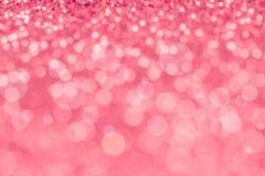 Iluminação cor-de-rosa doce do bokeh do borrão abstrato da textura do brilho imagens de stock