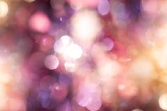Iluminação de incandescência do bokeh do borrão abstrato no partido da noite Fotos de Stock