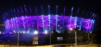 Iluminação do estádio nacional da fachada em Varsóvia, Polônia Fotografia de Stock Royalty Free