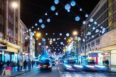 A iluminação do Natal das lojas da rua do Reino Unido, Inglaterra, Londres Oxford ilumina 2015 anos novo Fotografia de Stock