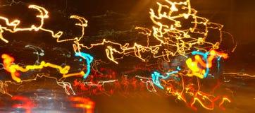 Iluminação na noite na estrada em uma cidade - apresse o conceito Fotografia de Stock