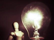 Iluminación de la muñeca de la idea Imagenes de archivo