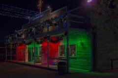 Iluminación de la Navidad de la tienda del oeste salvaje vieja Imagen de archivo libre de regalías