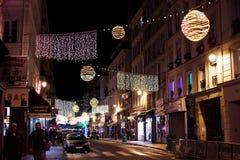Iluminación de la Navidad en París Foto de archivo libre de regalías