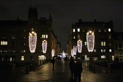 Iluminación de la Navidad en Riksbron en Estocolmo Imagenes de archivo