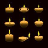 Iluminación de velas del diwali de la cera con la llama en la noche eps10 Foto de archivo libre de regalías