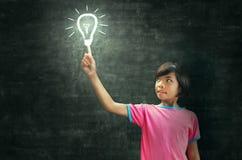 Iluminación y pizarra de los niños Fotos de archivo libres de regalías