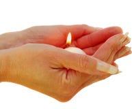 Iluminación de una vela Foto de archivo libre de regalías