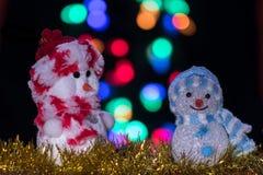 Iluminado dos muñecas del muñeco de nieve Imagen de archivo libre de regalías