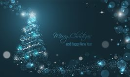 Iluminated Christmas tree with glitter, stars, snowflakes and transparent circles on a blue winter glowing  background. Merry Christmas and Happy New Year Royalty Free Stock Photos