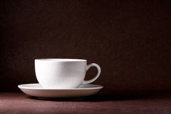Iluminated Cup. An iluminated cup on a dark background Stock Image