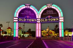 Iluminated entrance arches on colorful stores background at Old Town in 192 Highway area. royalty free stock images