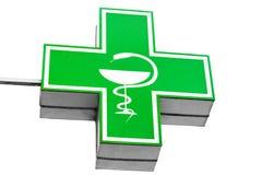 Iluminated gör grön läkemedelkorset som isoleras på vit bakgrund royaltyfri foto
