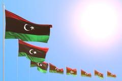 Ilustração agradável da bandeira 3d da festa - muitas bandeiras de Líbia colocaram diagonal com foco macio e espaço vazio para o  ilustração stock