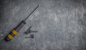 ilustração 3d de reparar a ferramenta, os parafusos e a chave de fenda Foto de Stock