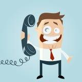 Homem dos desenhos animados no telefone Fotografia de Stock Royalty Free