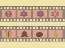 Ilustração de uma tira do filme com símbolos do Natal, atributos, flocos de neve Fotografia de Stock Royalty Free