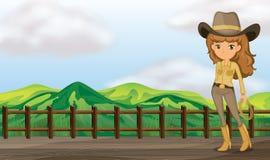 Uma vaqueira na ponte Fotos de Stock Royalty Free