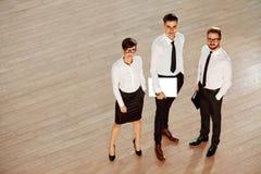 Ilustração do JPG + do vetor Sócios comerciais bem sucedidos Equipe do negócio Fotos de Stock