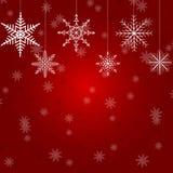 Ilustração do Natal com diversos flocos de neve de suspensão no fundo vermelho ilustração royalty free