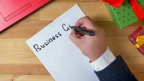 Ilustracja, nowy rok, mężczyzna ręki pisze w notatniku, 2019 biznesowych celów