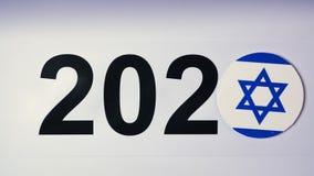 Ilustracja, nowy rok, męska ręka stawiająca dalej stół na japończyk flaga, kraj piłka, 2020