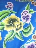 Ilustration de las flores en fondo azul foto de archivo