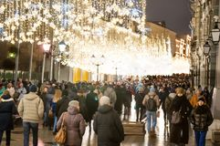 The Ilyinskaya street full of locals and tourists. Moscow-January 07: The Ilyinskaya street full of locals and tourists at Christmas time on January 07, 2018 in stock photography