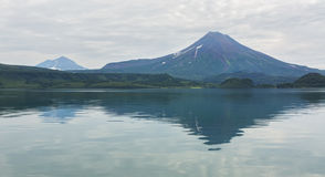 Ilyinsky stratovolcano near Kurile Lake. Stock Photo