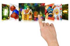 Imágenes de la Navidad del movimiento en sentido vertical de la mano Fotos de archivo libres de regalías
