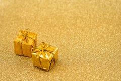 Imágenes de oro de la acción del fondo de la Navidad Fotos de archivo libres de regalías