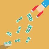 Imán del dólar del dinero en mano del hombre de negocios Imagenes de archivo