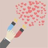 Imán que atrae corazones Foto de archivo