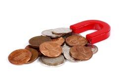 Imán y monedas Imagen de archivo libre de regalías