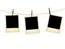 Im altem Stil Fotografien, die an einer Wäscheleine hängen Lizenzfreie Stockfotos
