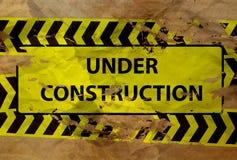Im Bau Zeichen auf Papier Stockbilder