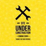 Im Bau Zeichen, typografisches Design Lizenzfreies Stockbild