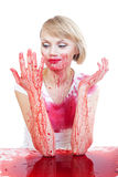 Im a bit dirty. Woman covered in red liquid Stock Image